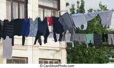 Clothes Weigh and Dry on a Rope in a Multi-Storey Building in a Poor Neighborhood of the City