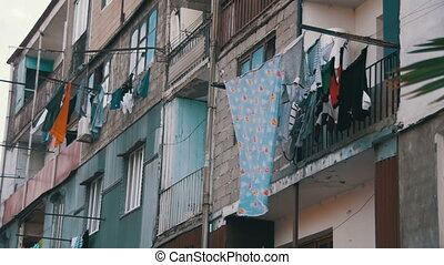 Clothes Weigh and Dry on a Rope in a Multi-Storey Building...