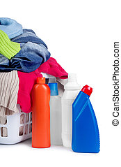 Clothes with detergent and in plastic basket dropped isolated on white