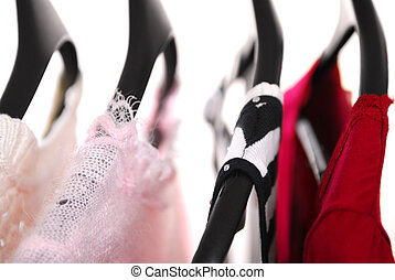 Women's clothing on a rack on black hangers