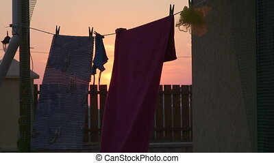 Clothesline in the backyard at sunset