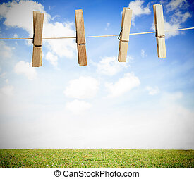 Clothespin on a laundry line outside with bright blue sky...