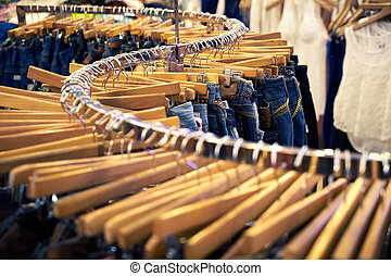 Clothing and retail store-view of shop with jeans. tif