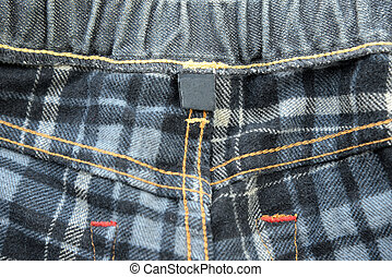Clothing back side of jeans with blank tag