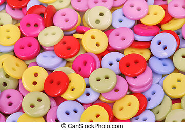 Clothing buttons - A scatter of brightly colored clothing...