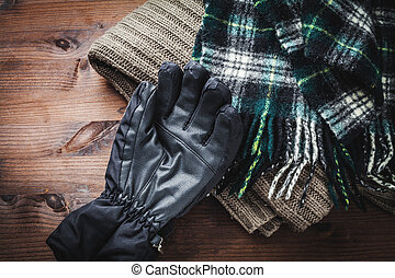 clothing for winter - sweater, scarf and gloves for the cold...