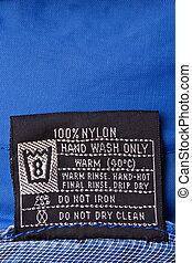 Clothing label on raincoat - Clothing label washing...