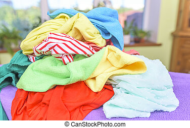 Clothing on the ironing board.