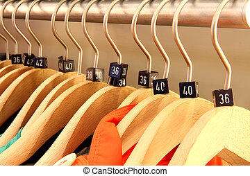 Clothing rack with wooden hangers - Close up of a clothing...