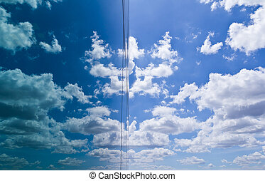 cloud and sky reflection in mirror of building