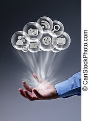 Cloud computing applications at your fingertips - male hand...