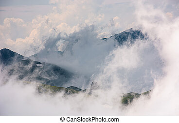 cloud formation in mountains on high altitude. spectacular...