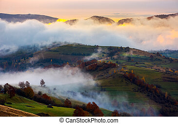 cloud inversion in autumn mountains at dawn