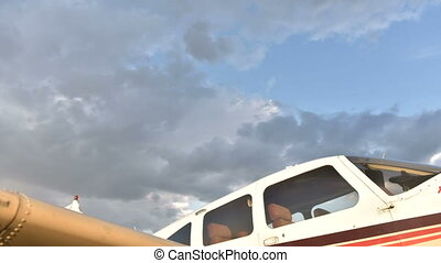 Cloud move above plane - Small lightweight private airplane...