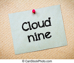 Cloud Nine Message. Recycled paper note pinned on cork...