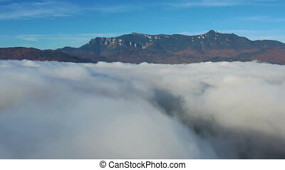 Cloud of mist over mountain lake in Romanian Carpathians.