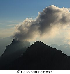 Cloud over mount Wendestock. View from mount Titlis. -...