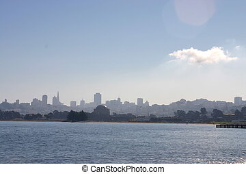 Cloud over SF cityscape - One cloud in the blue sky drifts...