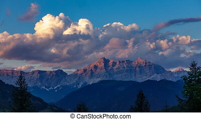 Cloud time lapse over dolomite mountain rocks profile
