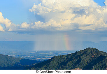 cloud with rain and rainbow over mountain at Khao Kho, Thailand