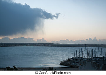 Cloud with rain sweeping out to sea
