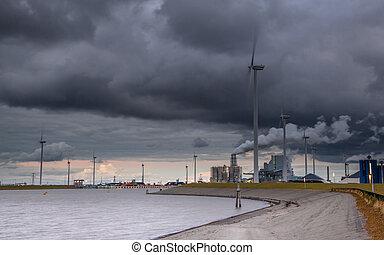 Clouded industrial harbor landscape - Eemshaven harbor at...