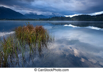 clouded morning on Barmsee lake in Alps