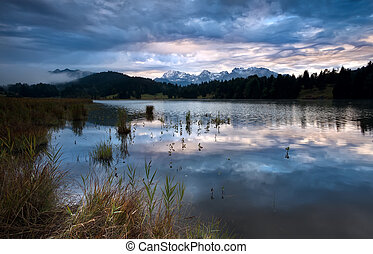 clouded sunrise over Geroldsee in Bavarian Alps