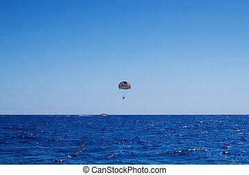 Cloudless day parasailing