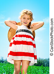 cloudless - Charming little girl on a meadow in summer day....