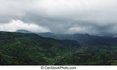 Clouds above mountain tops. Foggy rainforest. Flight over of...