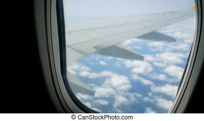 Clouds airplane window - View from airplane window clouds