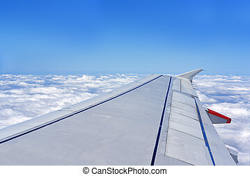 Clouds and aircraft wing.