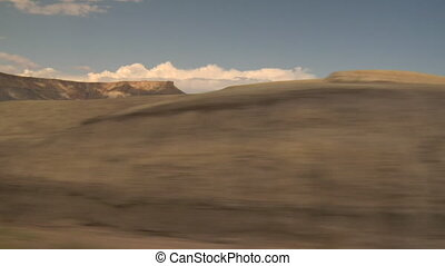 clouds and barren desert near Boulder Utah