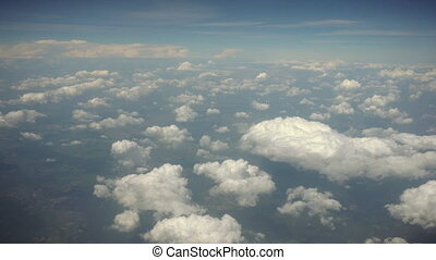 Clouds and Earth. View from a Plane Window