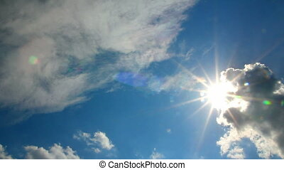 clouds and sun on blue sky