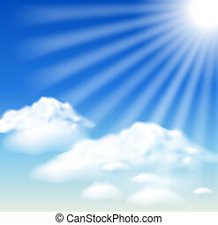 Clouds and sun rays in the blue sky