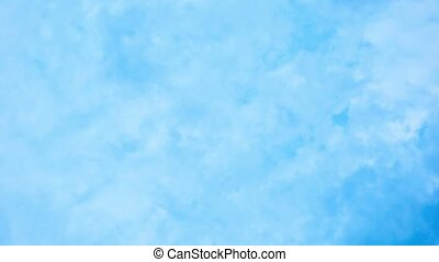 Clouds are flying high in the sky - heavenly background