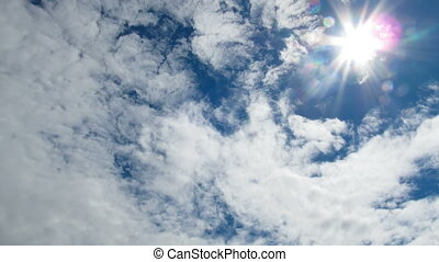 Clouds are Moving in the Blue Sky with Bright Sun Shining. TimeLapse