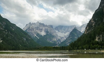 Clouds are Moving over the Peaks of the Alpine Mountains and...