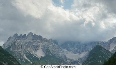 Clouds are Moving over the Top of the Alpine Mountains....