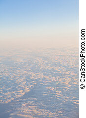 clouds at sunset from the plane in the sky landscape