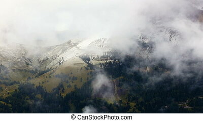 clouds covered mountains