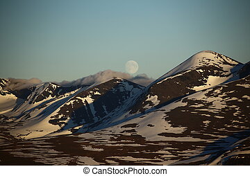 Clouds creeping over mountains in Abisko National Park in Sweden