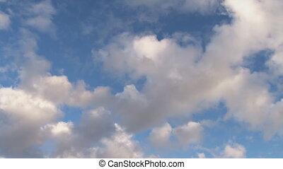 Clouds diagonal - Puffy cumulus move diagonally, clearing as...