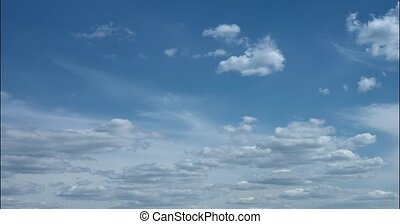Puffy, white clouds, drifting and billowing against a blue sky, in timelapse. Video 5k resolution