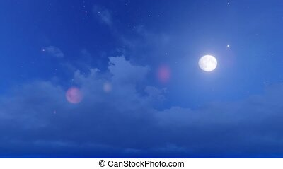 Clouds float on the background of the moon and the night sky.