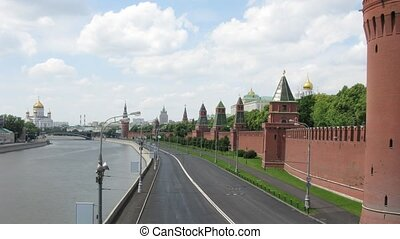 Clouds float on towers of Kremlin and domes of churches over...