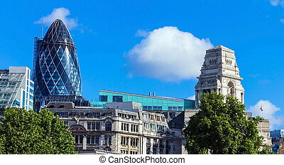 Clouds floating over the City of London with a Gherkin...