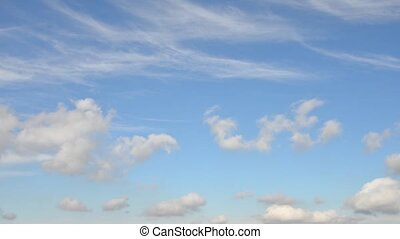 clouds flying in clear weather